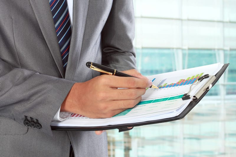 Business person holding checklist